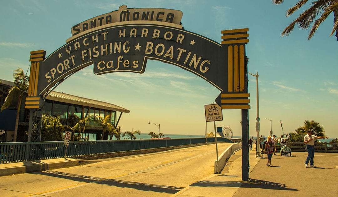 clear web proposition - sign showing what is on offer on santa monica pier