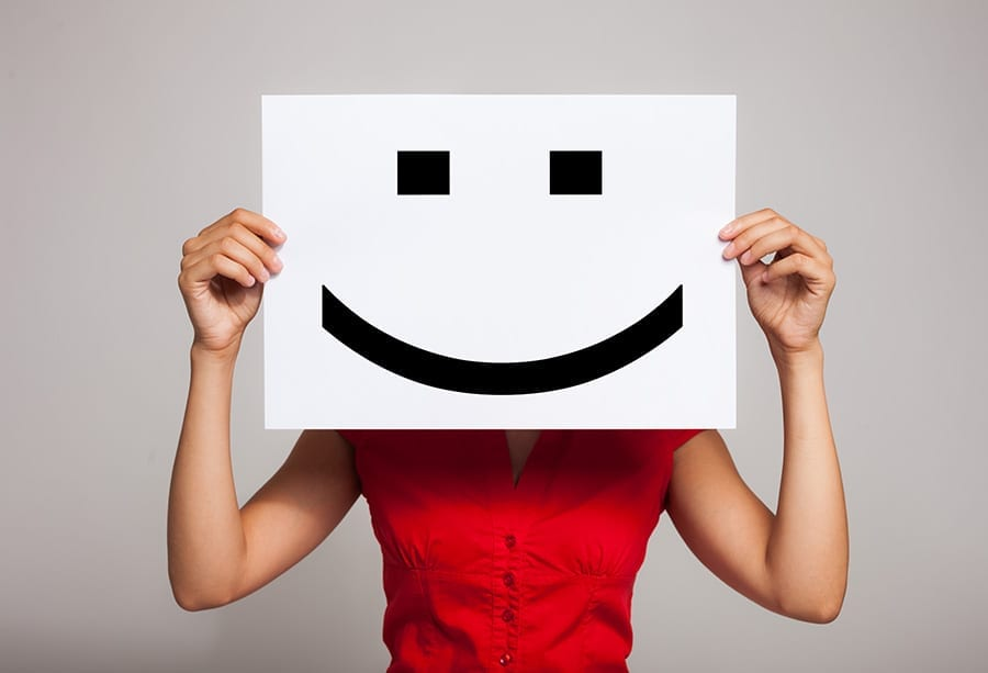 happy customer smiley face after good user experience online