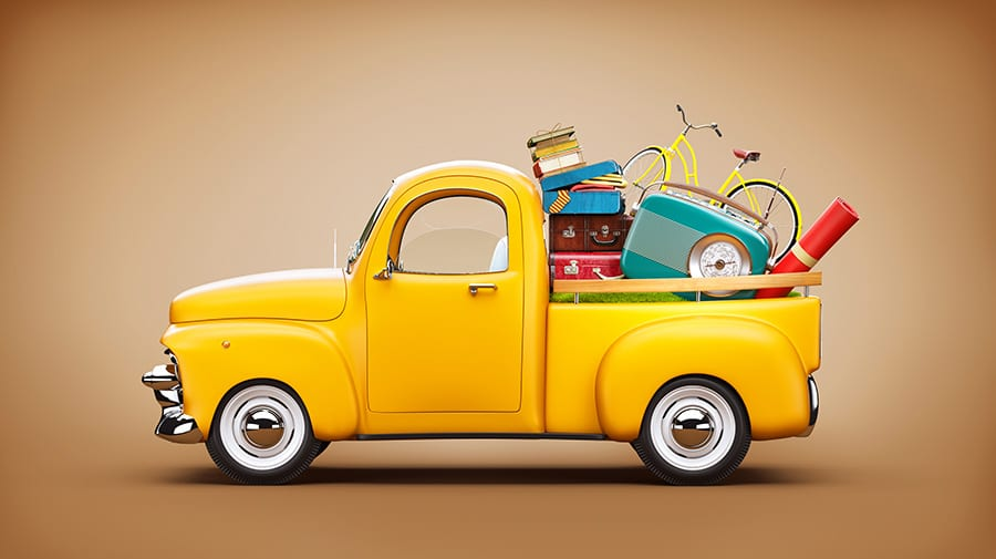 yellow pickup with items in trunk