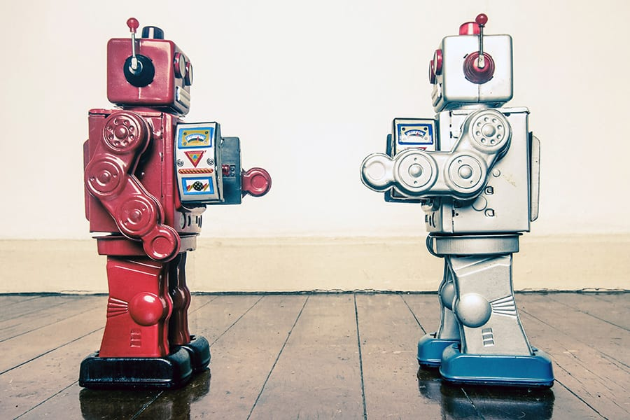 red and silver robots facing off