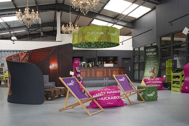 reception with big sign displays and beach chairs