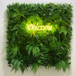 Multiple leaf sign with neon Welcome