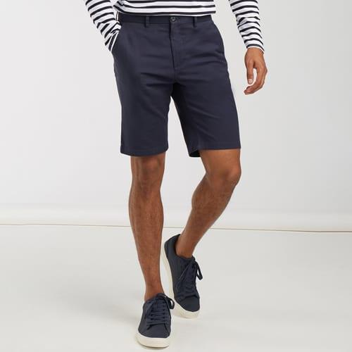 Close-up of man wearing dark blue shorts