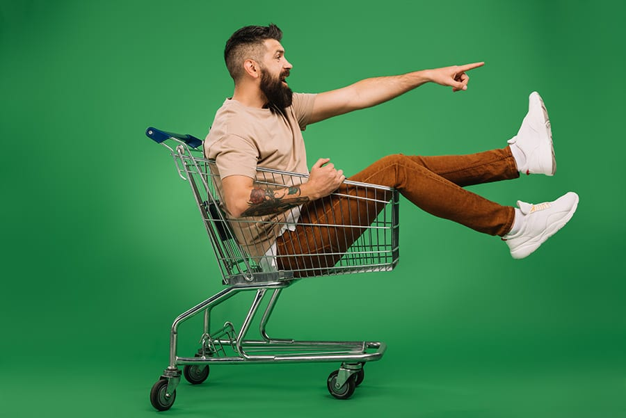 Man sat in trolley with green background